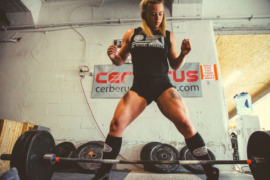female power lifter preparing to lift