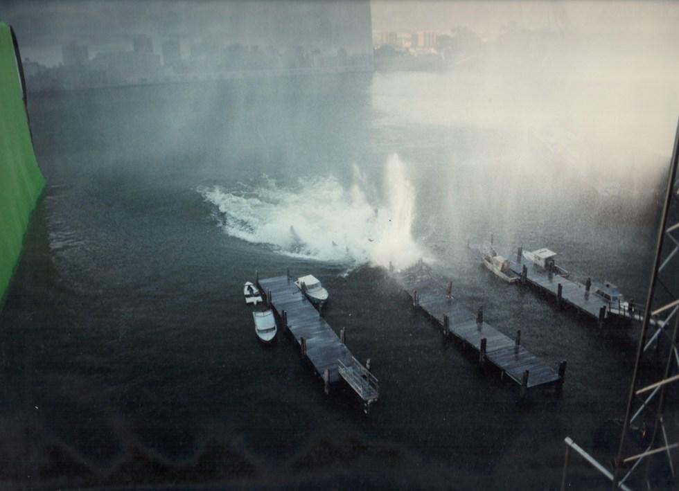 Destruction of miniature jetty with Godzilla head