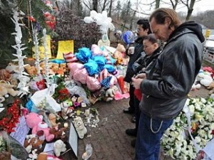 Newtown School Shooting Mourners | Why does God allow suffering?