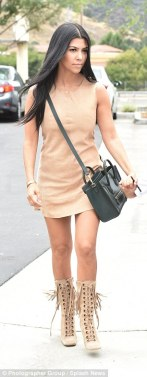 2ABB8C5300000578-0-Ready_to_mingle_Kourtney_looked_fantastic_in_a_beige_shift_dress-a-20_1437560503569
