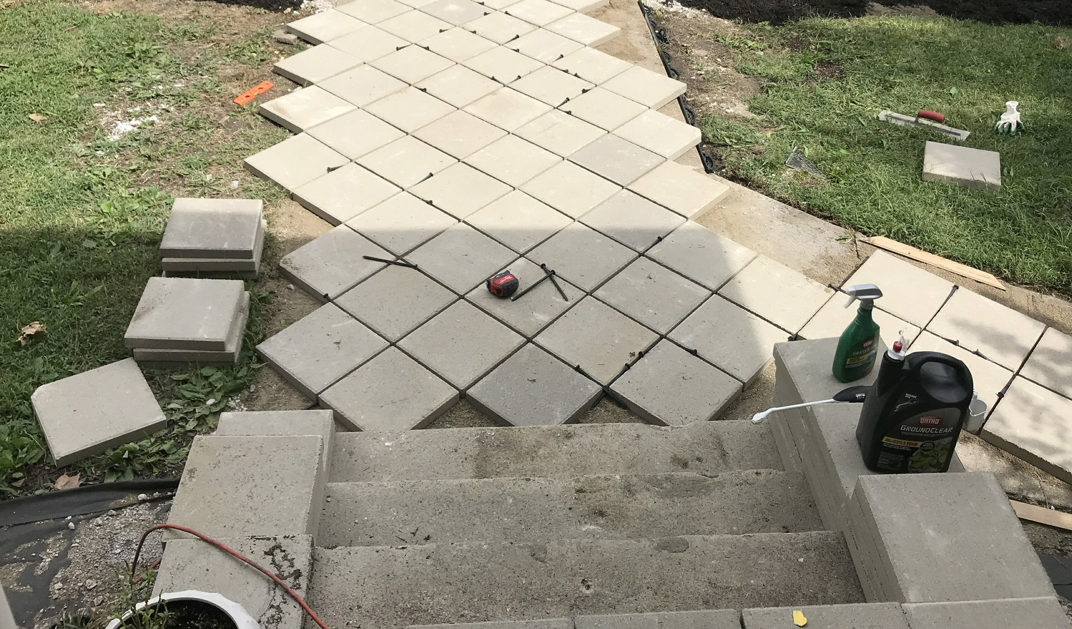 how to install pavers over old concrete