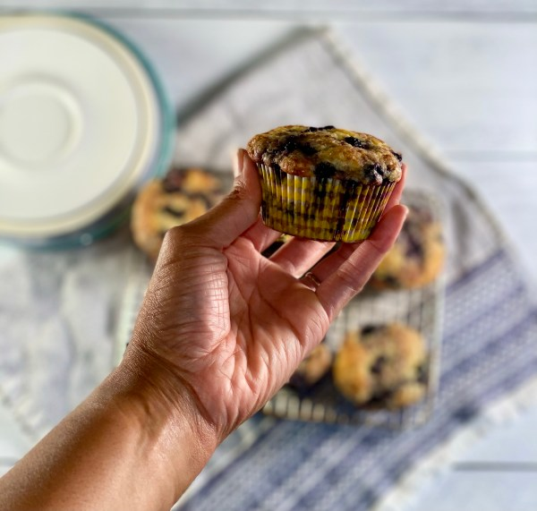 Blueberry muffins in hand.