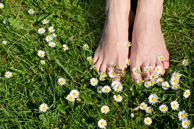 Earthing bare feet grass
