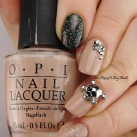 Neutral but Sparkly Skull Nail Art