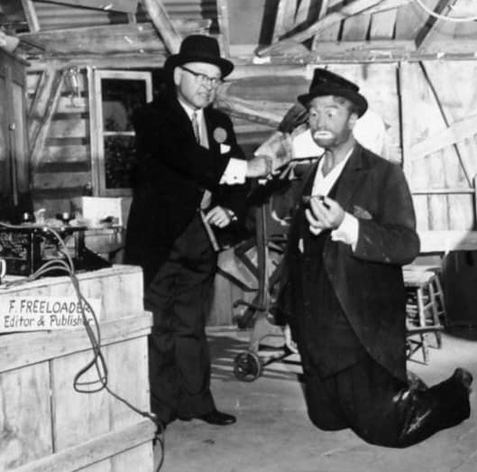 mickey rooney and red skelton as freddie the freeloader in a skit