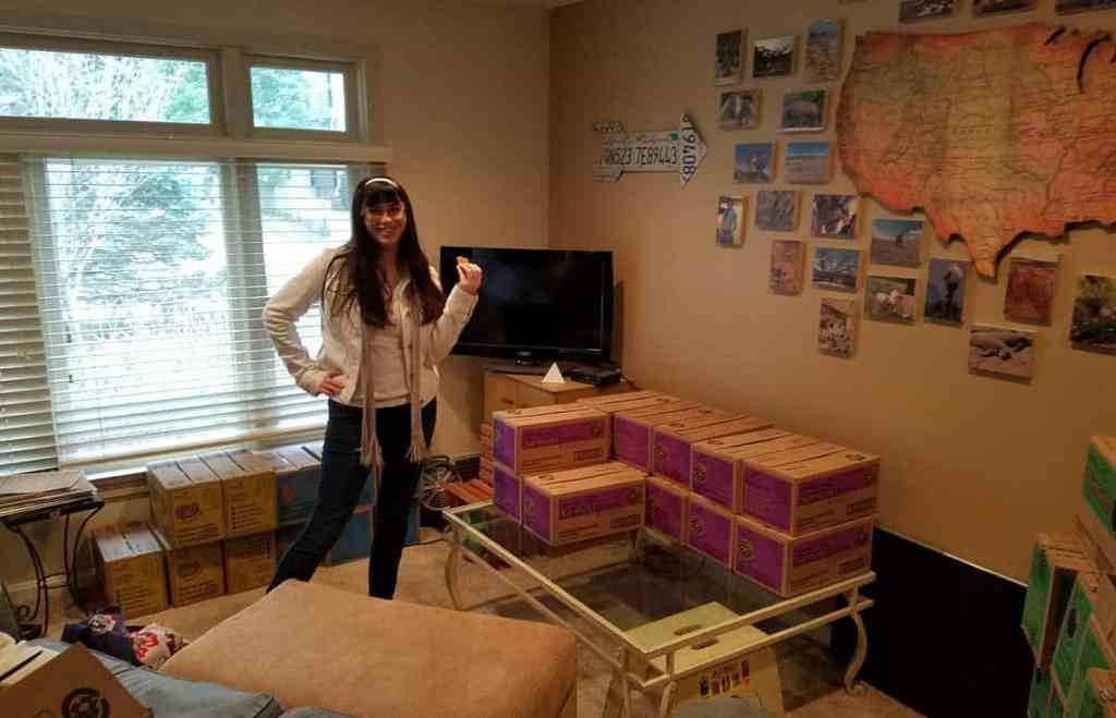 girl scout cookies by the case in the living room