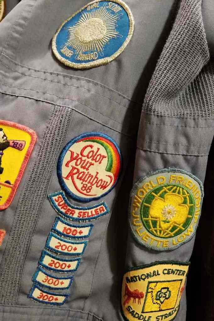 girl scout patch jacket with cookie sales patches and national center west patch and silver award patch