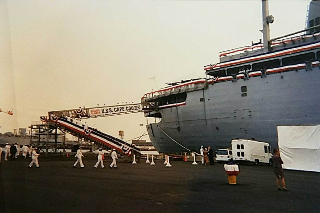 USS Cape Cod (AD-43) in port with dressed rails