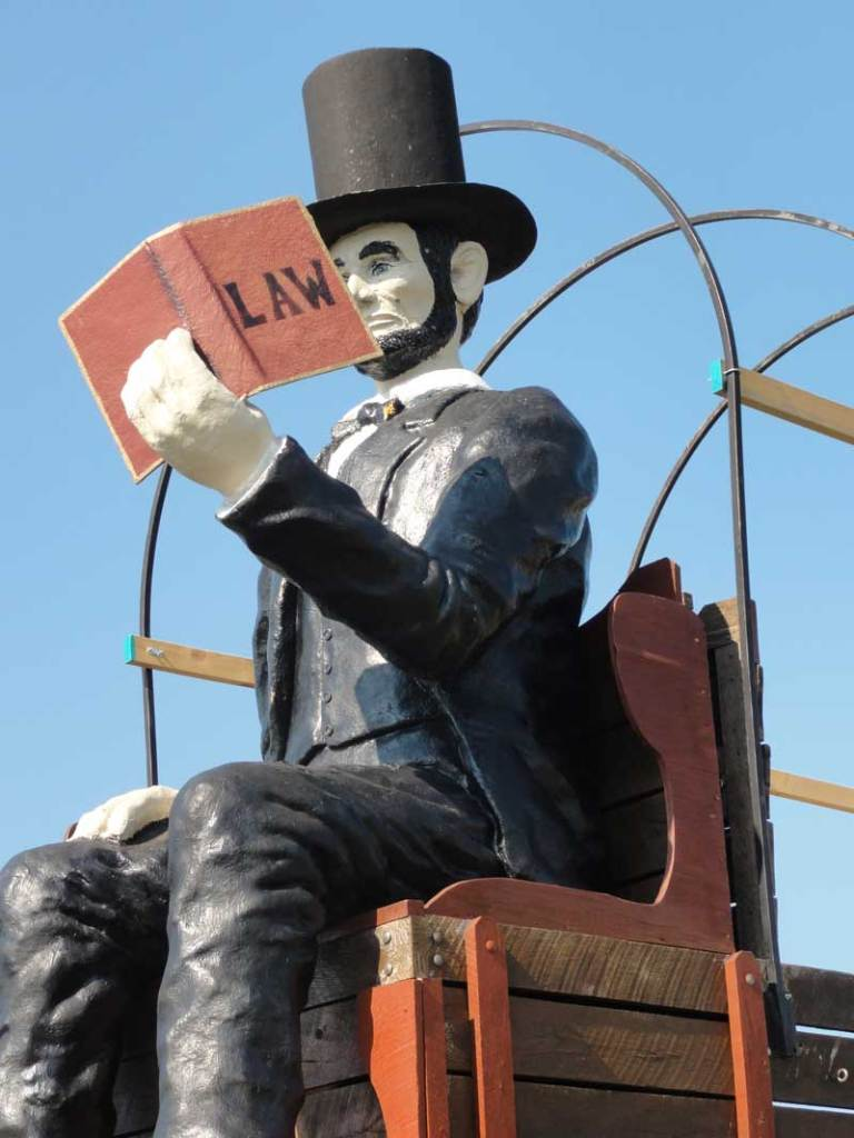 Close up of Lincoln reading a law book on the World's Largest covered wagon in Lincoln, IL