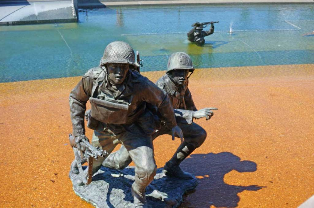 In the reflecting pool at the National D-Day Memorial, you can see several sculptures placed there to represent the men storming the beach.