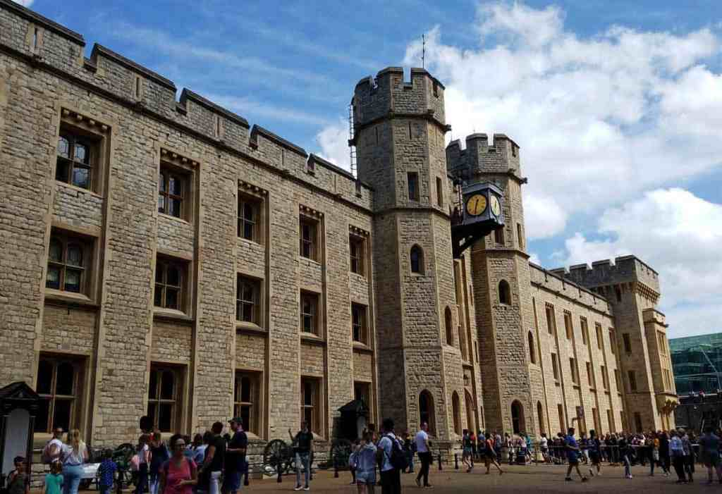Tourists milling about outside the stone building which houses the crown jewels on display at the Tower of London
