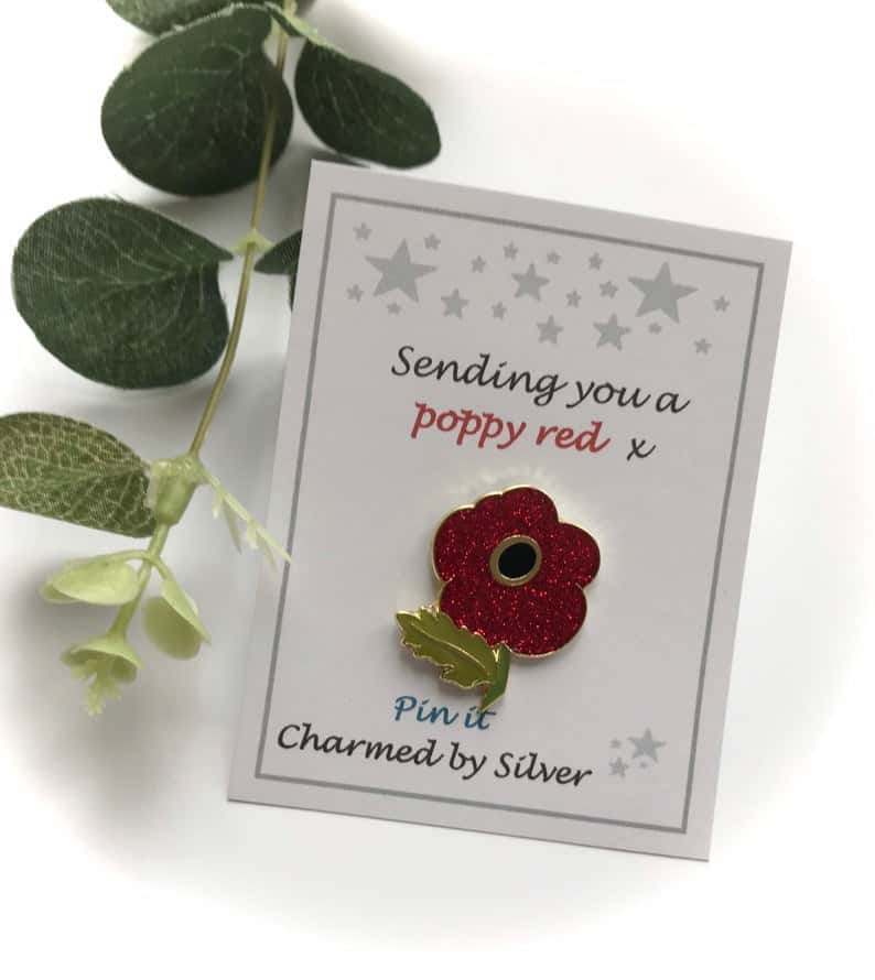 small poppy pin on a card made by Charmed By Silver