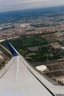 Departing north, my plane making a 180º turn south toward Atlanta. The Wells Fargo Center is visible just forward of the wing.