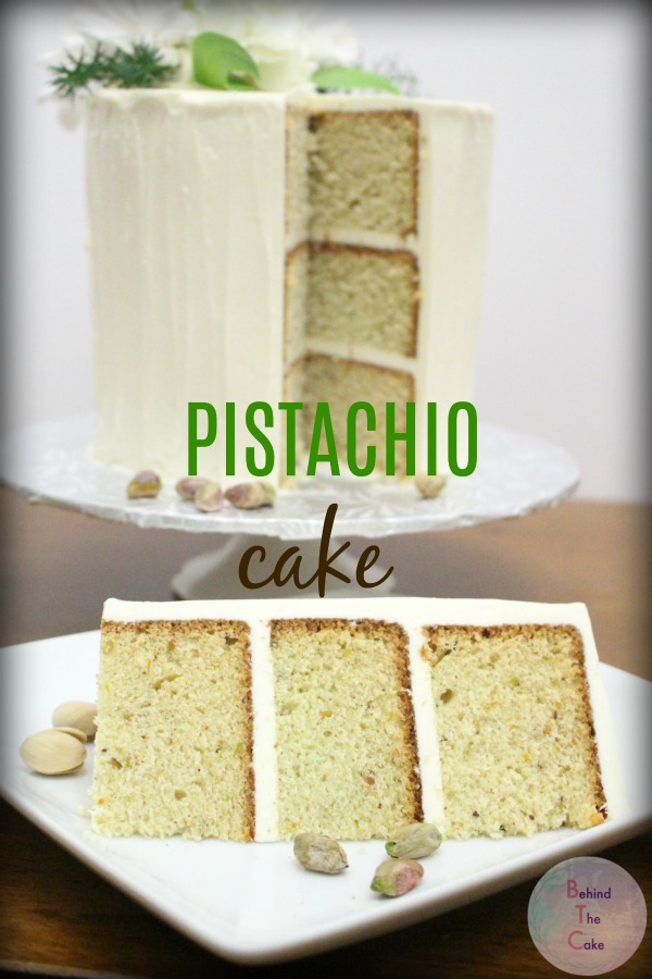 Behind the cake. White buttercream frosted pistachio cake with fresh flowers