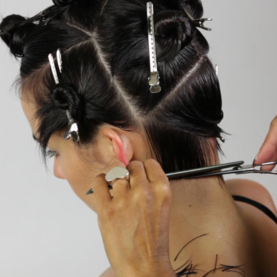 Cut a one-length line that rounds upwards from the nape to just below the ear