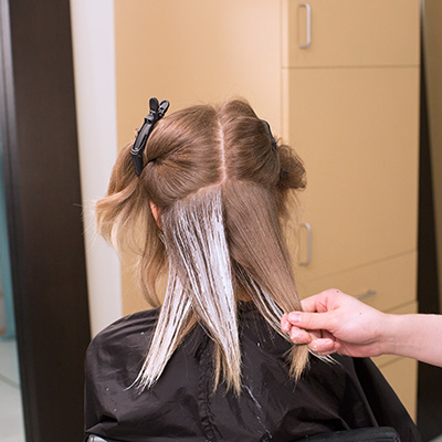 take alternating diagonal-back and diagonal-forward partings, working the product onto the surface of the hair