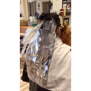 hair processing in foils during color correction appointment