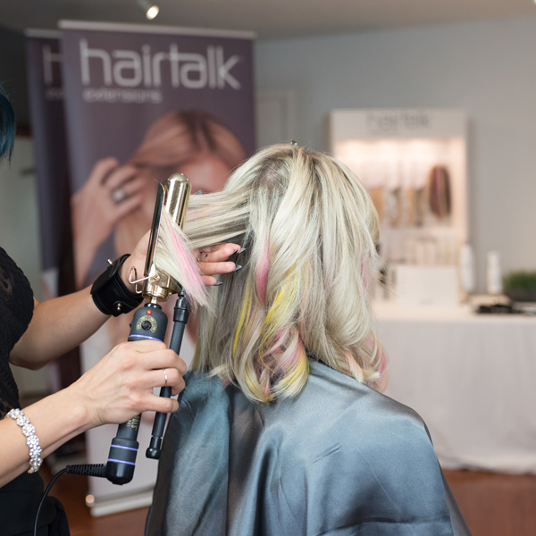 Curling extensions from hairtalk extensions using pops of color and a Hot Tools Marcel Iron step by step photos