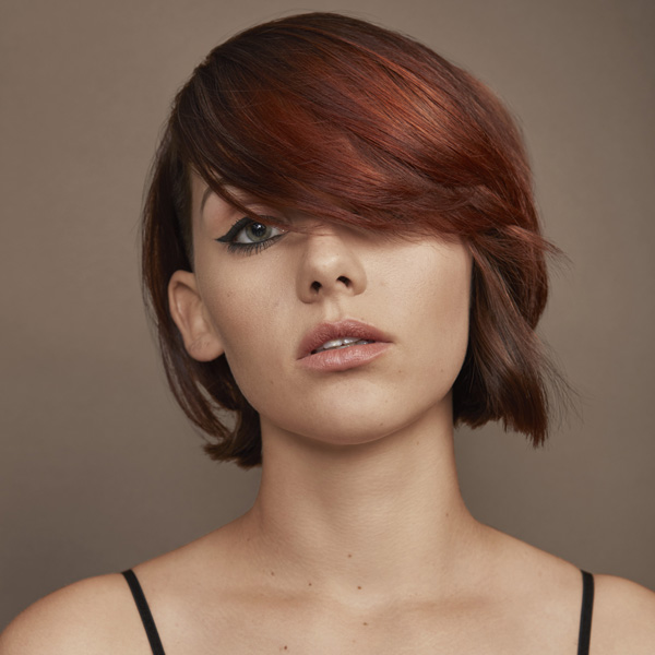 redken brunette with tones of copper short hair color blocking technique