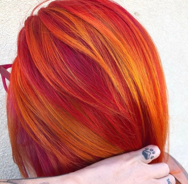 orange and red fashion hair color by @samihairmagic