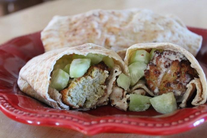 falafel with tahini sauce in pita with cucumbers