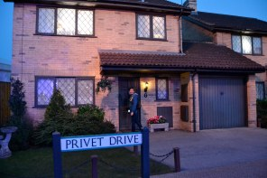 Knocking on the door of the Dursley's house