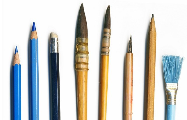 Different brushes, pencils and tools of an artist, isolated on white background