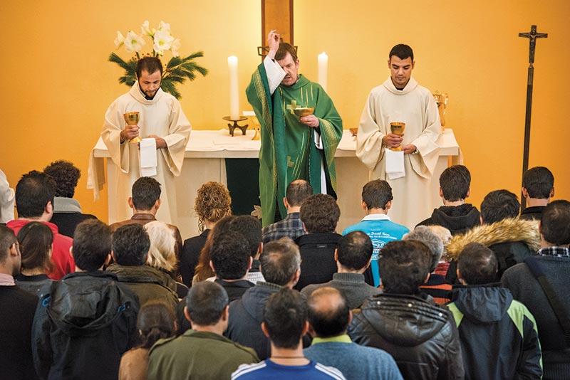 iranian-refugees-receiving-communion