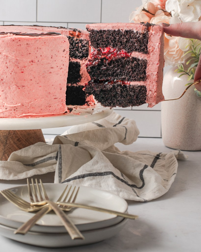 This image throws the three layers of the cake.  Between each layer there is strawberry buttercream and strawberry jam.