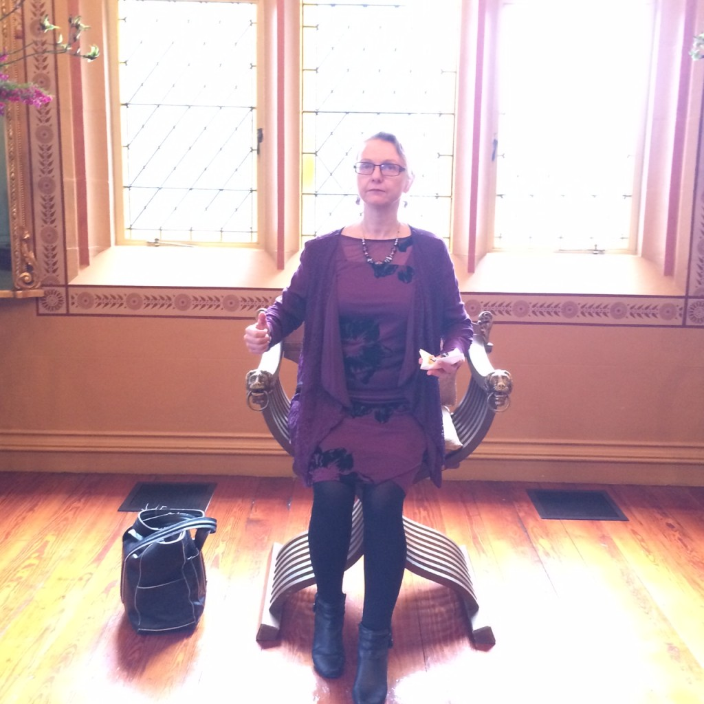 Our CEO Peri sitting in one of the beautiful antique chairs at NSW Government House.