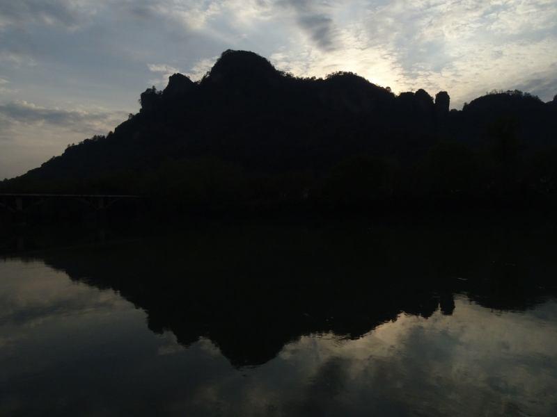 Silhouette of Da Wang Peak over the Chongyang Brook