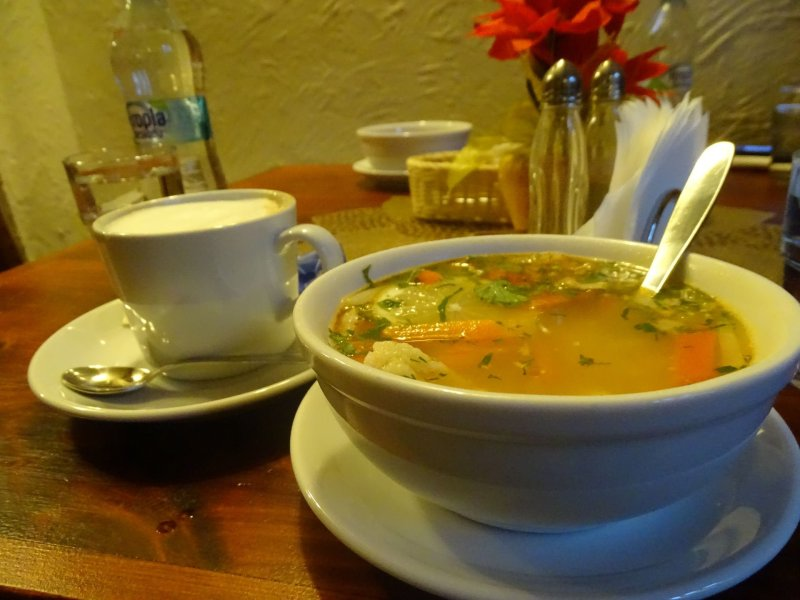 Light fish soup with a coffee on the table