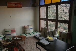 Hotel room with window sofas, Western Morocco divan style
