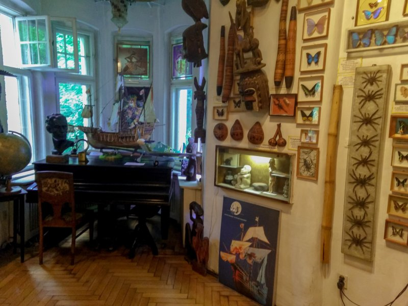 Inside of the museum: piano, butterflies and other souvenirs