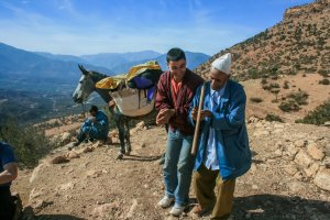 Mohammed and younger guide singing, mule in bacgkround