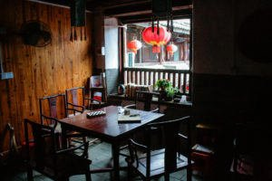 Table and chairs by window which overlooks Fuyulou