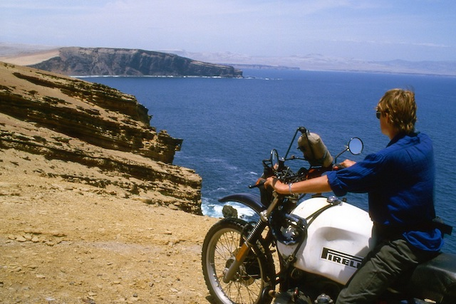 Wilma Allan, around the world trip, sitting on motorbike beside the Peruvian Coast PanAm highway