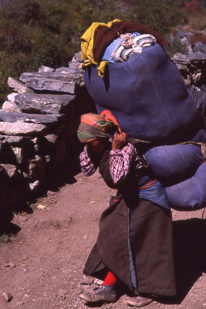 Something extraordinary - Nepali woman carrying enormous burden on back