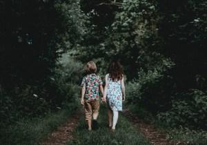 mark: children holding hands friend