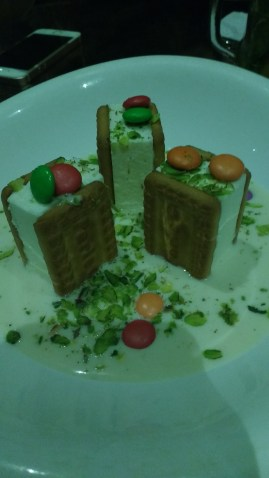 Parle-G cheesecake. One is supposed to lift the Parle-G and dip it in the ras malai