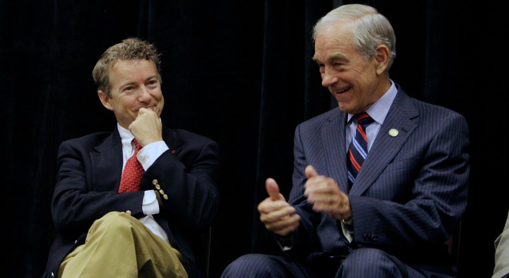 Republican U.S. Senate candidate Rand Paul, left, enjoys a light moment with his father U.S. Rep. Ron Paul, R-Texas, during a campaign event in Erlanger, Ky., Saturday, Oct. 2, 2010.  (AP Photo/Ed Reinke)