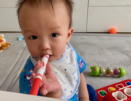 Boy-with-red-Caryola-pen-in-his-mouth-1