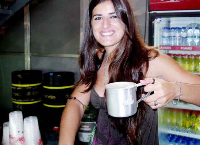 Lovely lady happily filling my metal mug