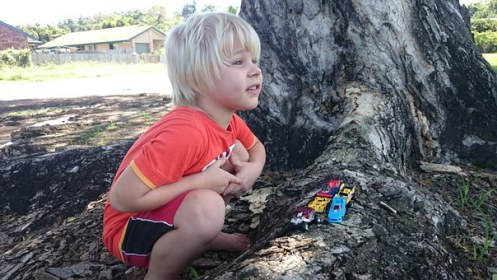 kid playing with his cars
