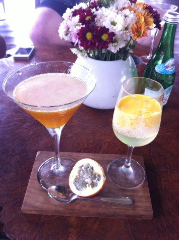 Millonaire martini, vanilla vodka, passion fruit liqueur with a champagne and passion fruit foam chaser