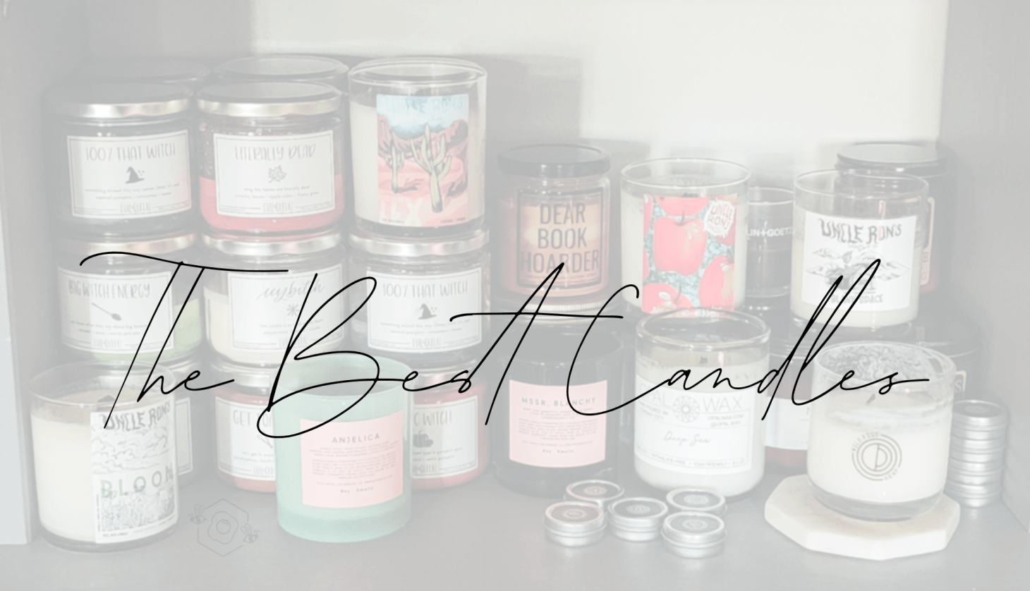 A head-on shot of about half my candle collection on my bookshelf. Text overlay reads The Best Candles