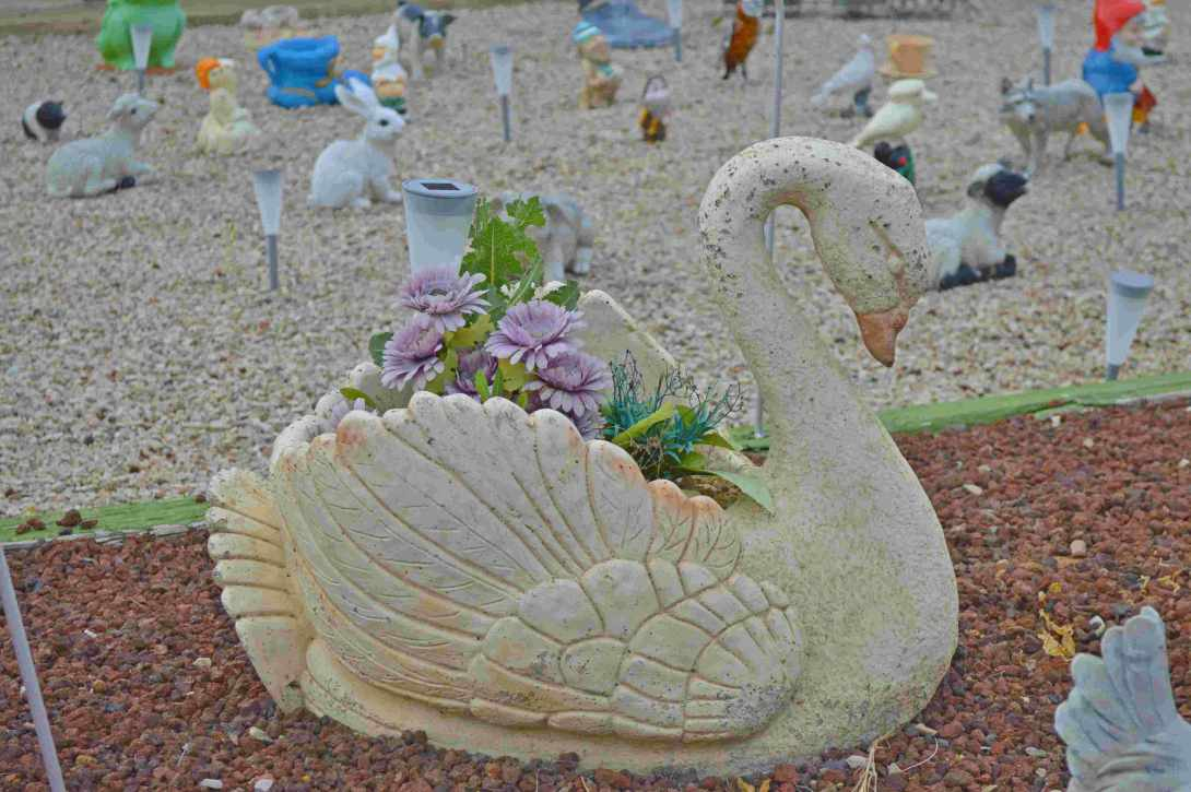 Swan Planter with fake flowers