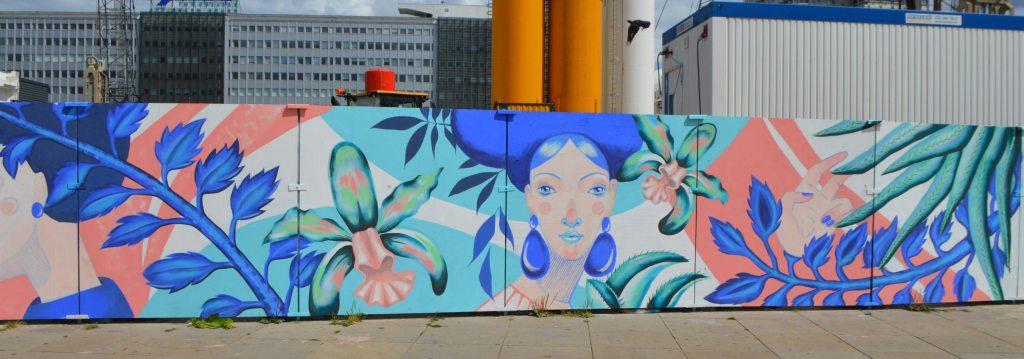 In Bllom by Kiki and Rommy - Berlin Alexanderplatz street art mural construction site - bekitschig.blog