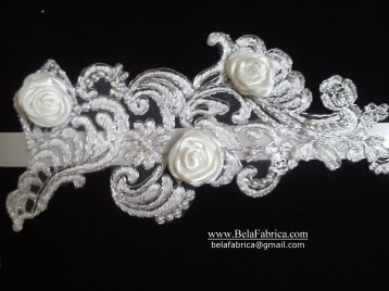 Silver corded lace with ivory rosettes