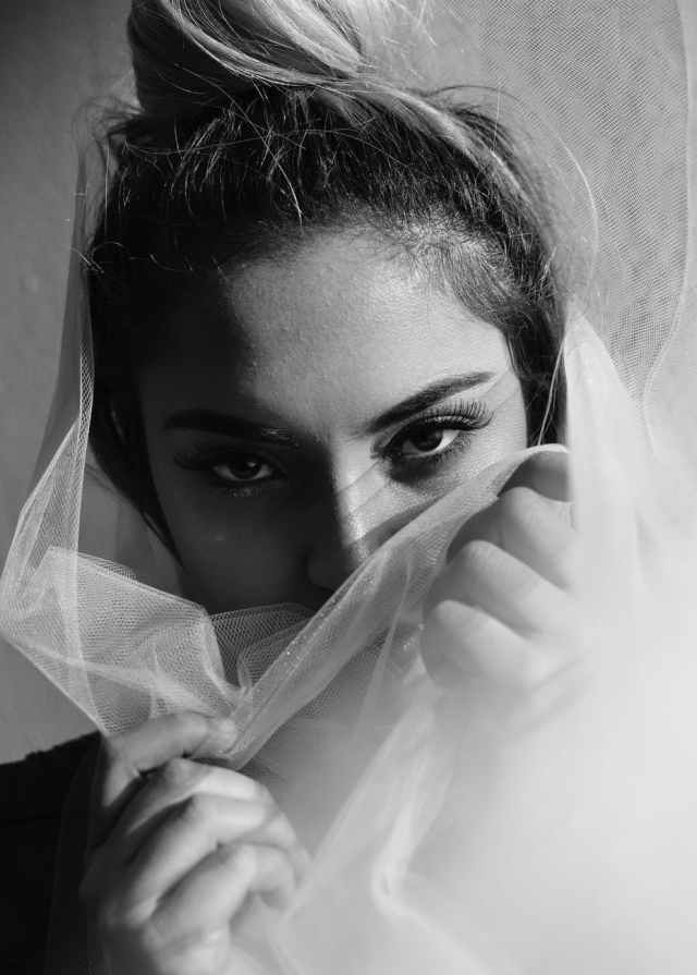 grayscale photography of woman covering her mouth